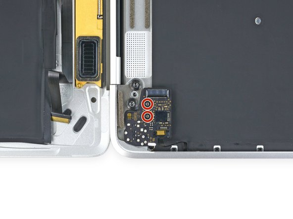 Remove the two 3.2 mm T5 Torx screws securing the audio jack board to the case.