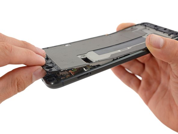 This slim and rigid midframe is likely made of magnesium, and is clipped (really firmly) onto the body of the phone.