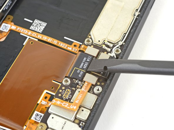 Use the flat end of a spudger to disconnect the charging cable connector by prying it straight up from the motherboard.