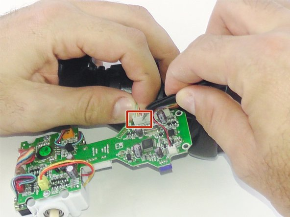 Use the precision tweezers to unplug the bundle of wires.