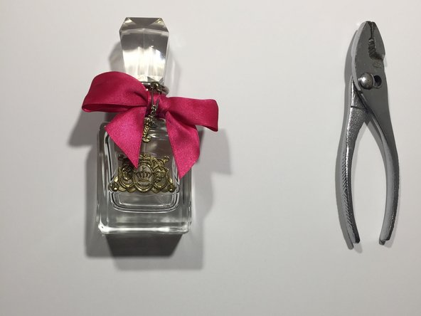 Obtain the damaged perfume bottle and a pair of pliers.
