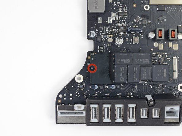 Remove the single 5.3 mm T8 screw securing the SSD to the logic board.