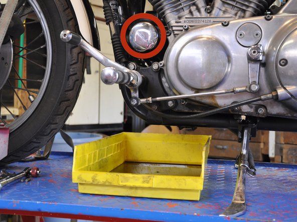 The oil filter is located at the front of the engine, between the frame downtube and front cylinder.
