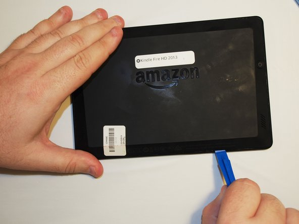 Open up the device by using a plastic opening tool in order to avoid damaging the device.