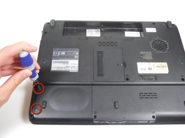 Flip the laptop over so that you can see the back. Make sure that the volume scroller is closest to you when it is flipped over.