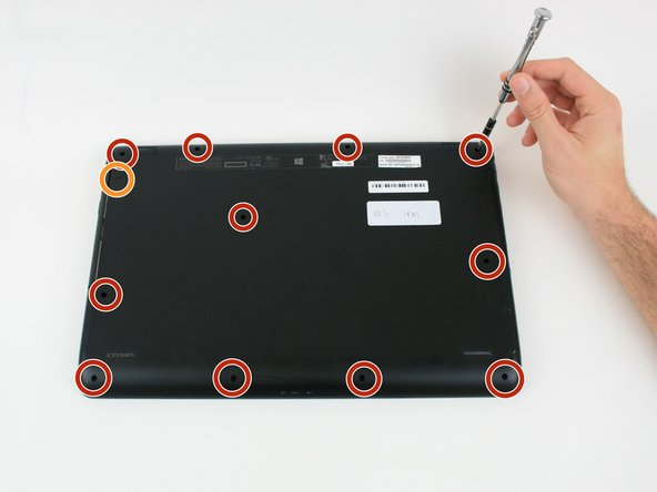 Unscrew the eleven 6 mm screws from the back panel on the bottom of laptop with the Phillips #0 screwdriver.