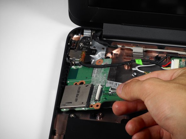 Lift the module up and out of the laptop.