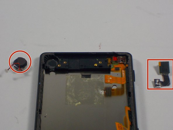 With the plastic covering removed. carefully pry off the signal receptor and front camera.