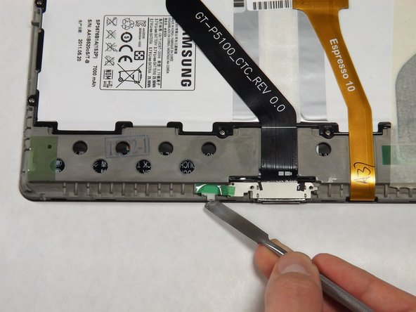 Use the flat end of the heavy-duty spudger to lift the white microphone piece until it is removed from its socket.