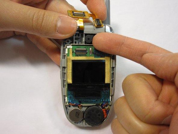 While holding the copper connection out of the way, use your fingernail to pry the camera out of its socket.