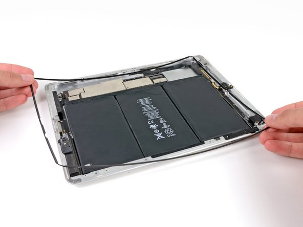 When the adhesive has been released along all the edges of the iPad, lift the plastic display bezel off of the iPad.