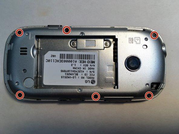 Dévissez les six vis de 2 mm situées sous le panneau arrière.
