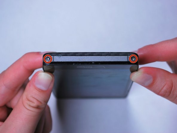 Use the Torx T5 Screwdriver to remove two 5.0 mm screws at the bottom of the phone.