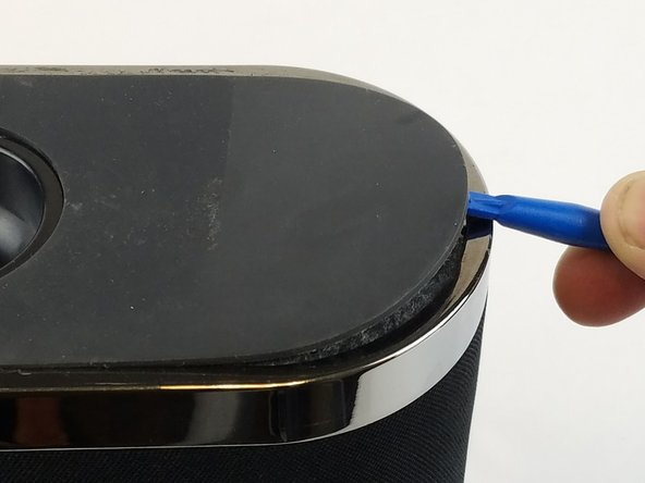 Remove the rubber from the bottom of the speaker, use a medium blue plastic spudger to gently work its way under the rubber and slowly peel off for each of the three feet. The order does not matter.