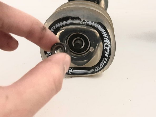"""Using the 1/2"""" side of the Skate Tool, screw the nut back on the axle to hold the wheel in place."""