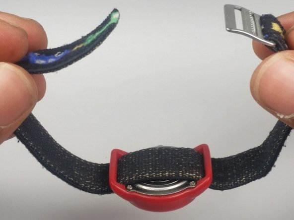 Once the strap has been unlocked, hold onto the strap buckle and pull  away from the watch to completely remove the band.