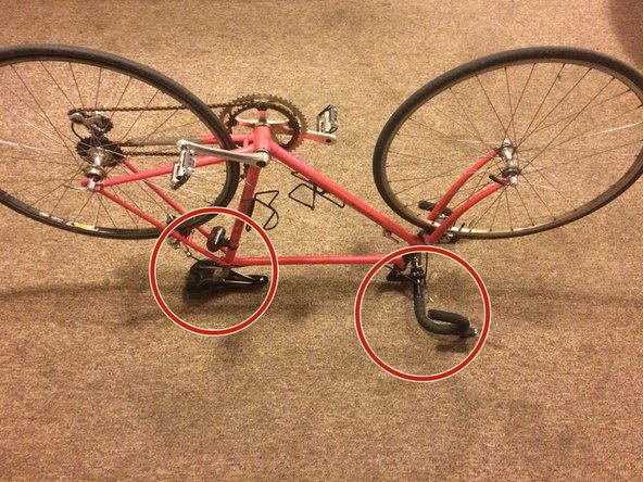 Flip the entire bicycle upside down, balancing the weight on the seat and handle bars.