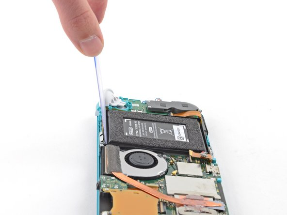 Once there's enough room, insert a plastic card underneath the battery and slowly pry the battery up.