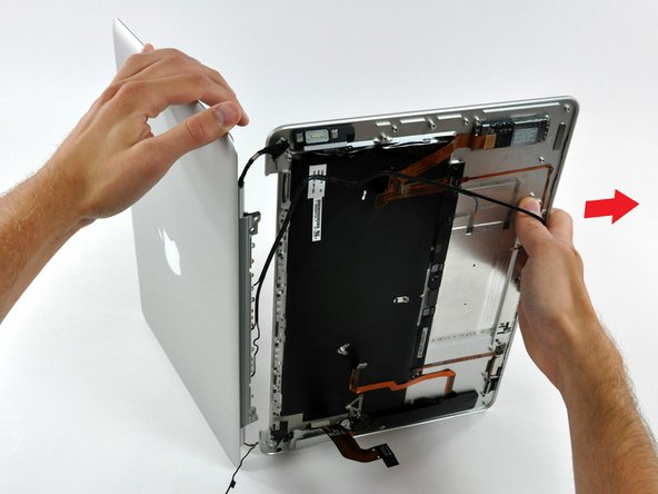 Pull the upper case straight away from the display, minding any cables that may get caught.