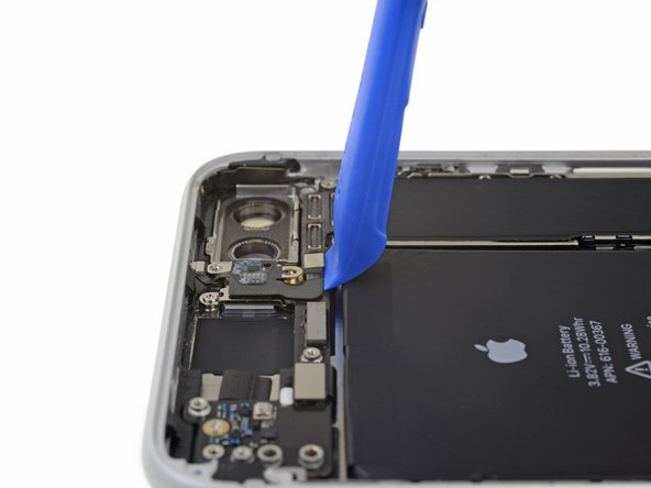 Use a fingernail or the sharp end of an iFixit opening tool to pry up and disconnect the antenna flex cable connector from the logic board.