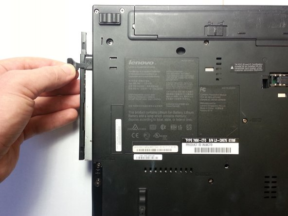 Once the tab pops out, pull it away from the computer to release the disc drive.