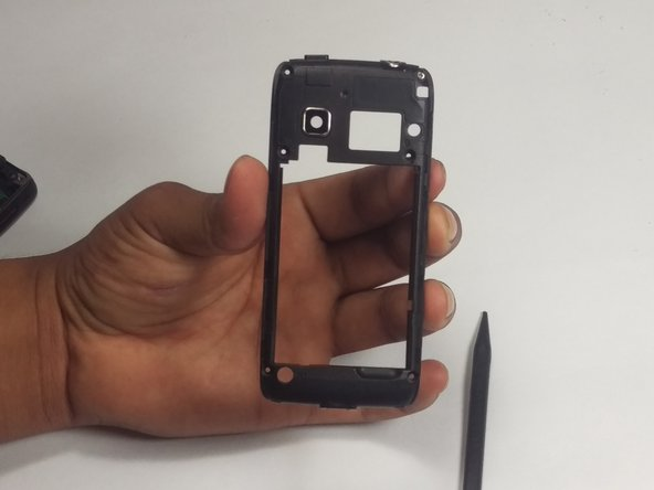Replace the secondary rear panel which has the camera lens attached.