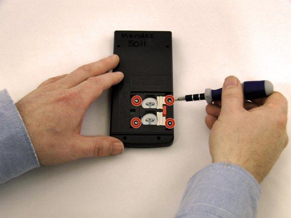 Using a Torx, T-6 star-bit screwdriver, unscrew four 7.38 mm screws from battery housing.