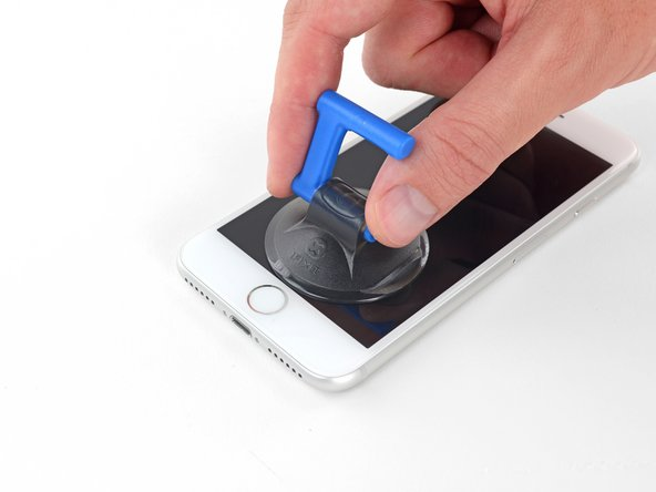 Apply a suction cup to the lower half of the front panel, just above the home button.