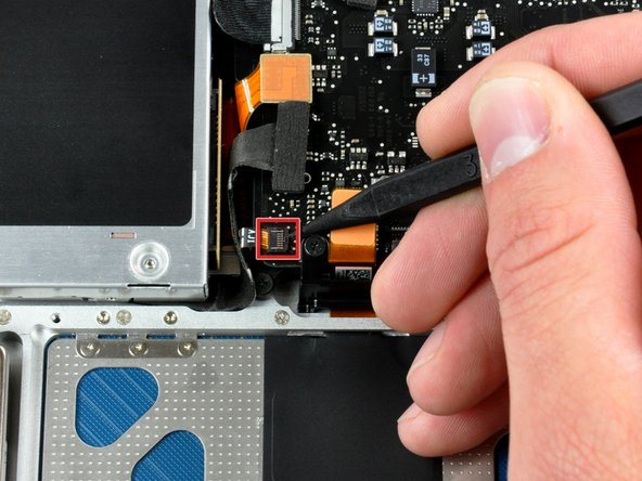 Use the tip of a spudger to flip up the locking lever to release the IR sensor ribbon cable from its socket.