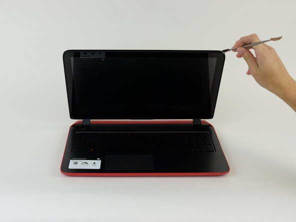 Use metal spudger to pry the screen from the back panel.