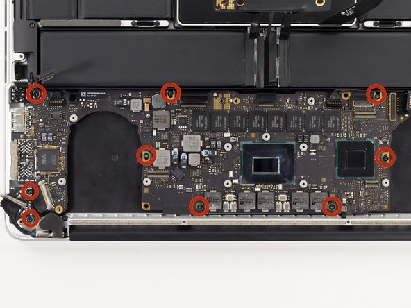 Remove the nine 3.3 mm T5 Torx screws securing the logic board and MagSafe DC-in board to the upper case.