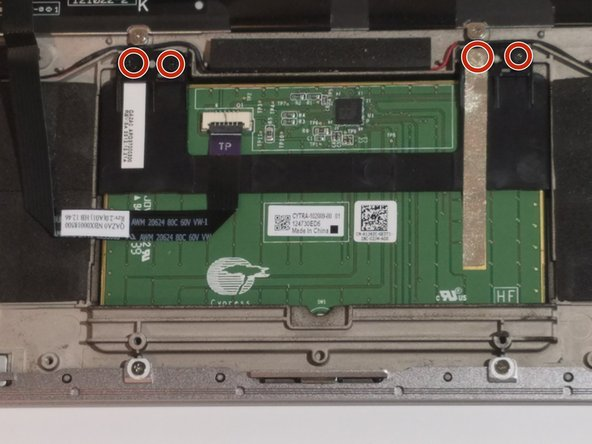 Use a Phillips #00 screwdriver to remove the 4 trackpad screws.