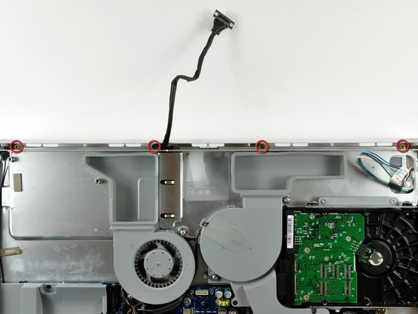 Remove the four coarse-thread 7.8 mm Phillips screws along the top edge of the iMac.