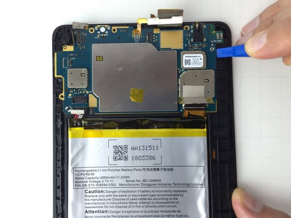 Position  the iFixit Opening Tool beneath the motherboard and pull upwards to remove the motherboard from its case.