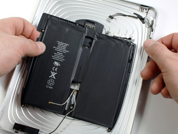 When there is enough clearance, use your hands to peel the battery off any adhesive still securing it to the rear panel.