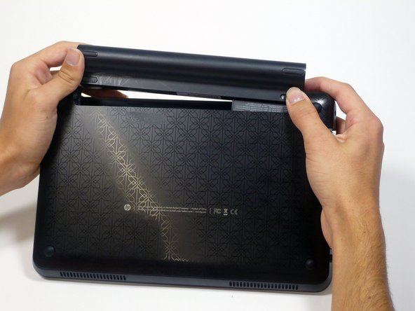Slide the battery out from the netbook.