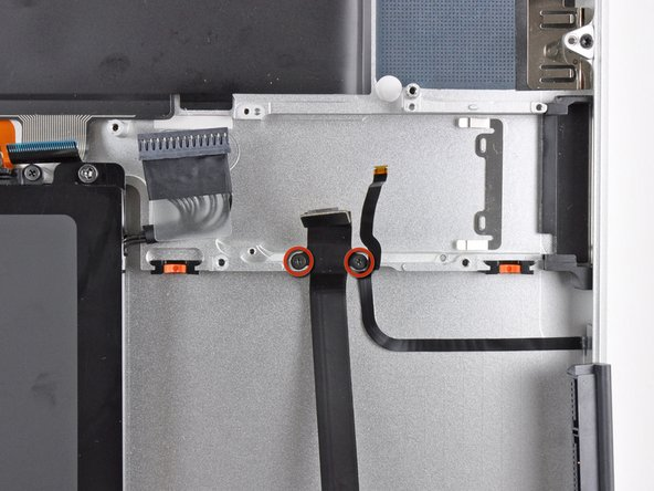 Remove the two 2.2 mm Phillips screws securing the hard drive cable to the upper case.