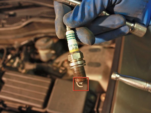 Determine if the spark plug needs to be replaced by examining the gap for the problems listed below: