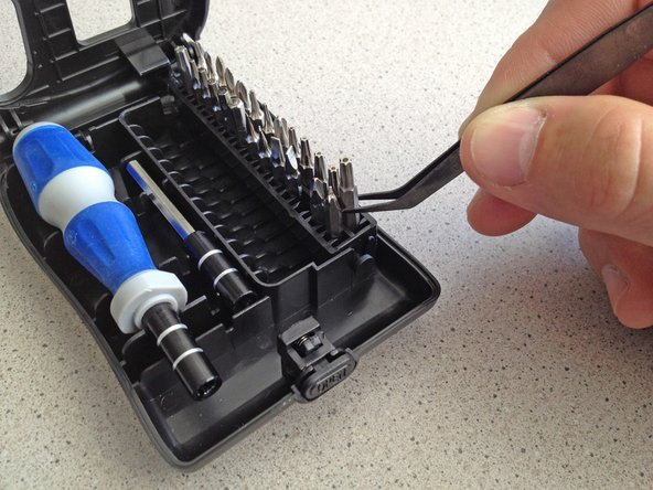 Alternate, no-rubber-band solution: use the tweezers supplied in the bit driver kit.