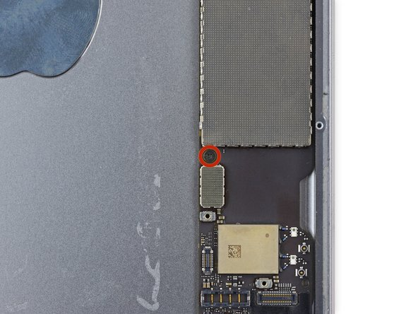Remove the single 1.3 mm Phillips #00 screw from the logic board.