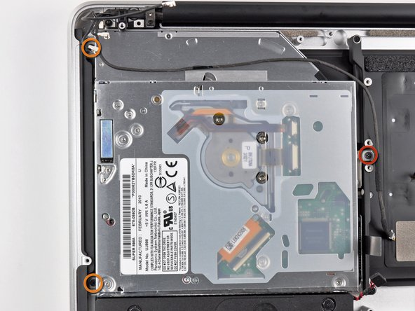 Remove the following three Phillips screws securing the optical drive to the upper case: