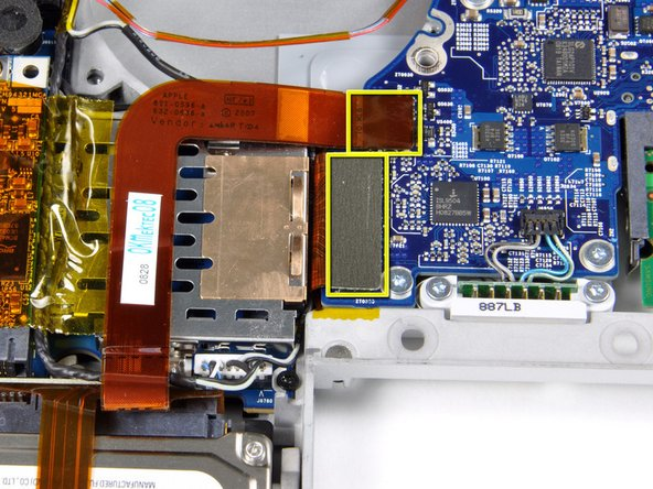 Disconnect the hard drive and ExpressCard connectors from the left side of the logic board.