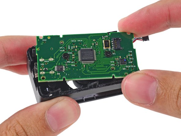 Once inside, the positional camera's motherboard and lens assembly are removed with ease.