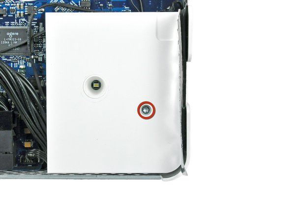 Remove the single T10 Torx screw securing the right speaker to the logic board.