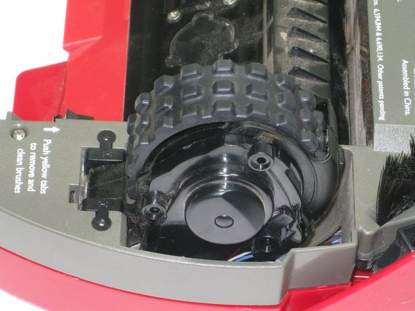 Using a Phillips Head screwdriver, remove all three screws on the side of the hubcap of the wheel.