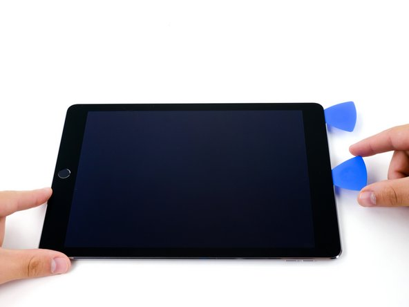 Slide the second pick along the top edge of the iPad, towards the Sleep/Wake Button.