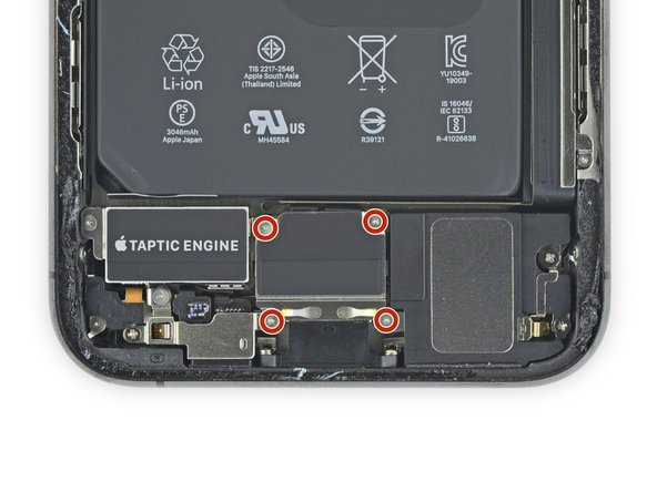 Use a Y000 driver to remove the four 1.5 mm screws securing the lower battery connector cover.