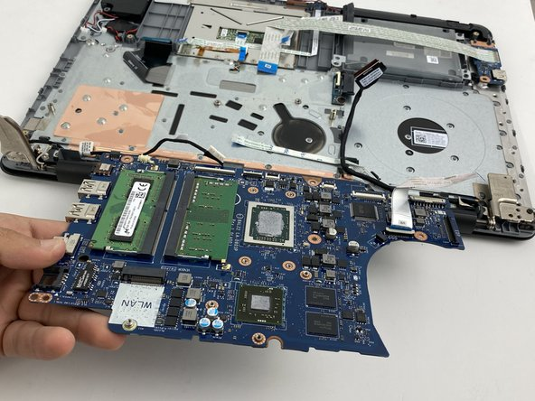 Lift and remove the motherboard.