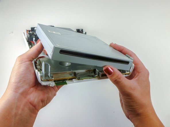 Rotate the device so that the DVD slot is visible.