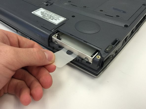 Pull the tab to remove the hard drive.